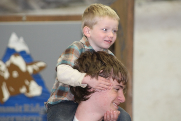 Karter loves being on shoulders! He will cover eyes and move heads. Here he is riding Uncle Lane.